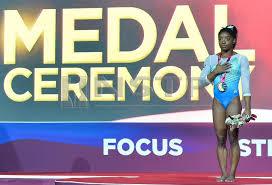simone biles first gymnast to win 13