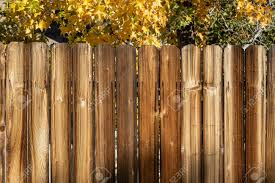 Rustic Wooden Fence Background With Yellow Fall Trees And Copy Stock Photo Picture And Royalty Free Image Image 120264285