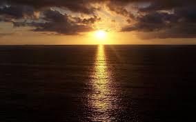 dark ocean sunset line reflect