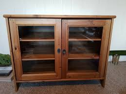 gl fronted wooden cabinet lockable
