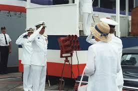 Admiral (ADM) Wesley L. McDonald, commander in chief, Atlantic and Atlantic  Fleet, salutes as his wife,