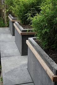 grey concrete paver raised garden bed