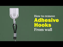 how to remove adhesive hooks from wall