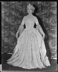 Peggy Hamilton modeling a period gown and crown at a fashion show at the  Biltmore Hotel, New York, 1927 — Calisphere