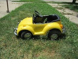 yellow vw electric pedal car from