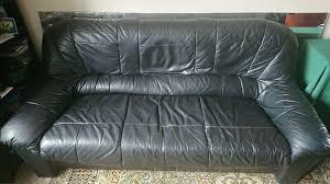 3 seater black leather sofa small tear