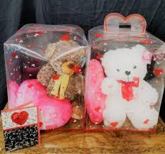 valentine teddy bear by flowers and