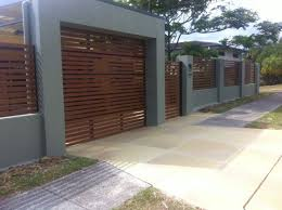 Block Retaining Wall Privacy Fence Carport With Automatic Matching Roller Door Carport Designs Facade House Roller Doors