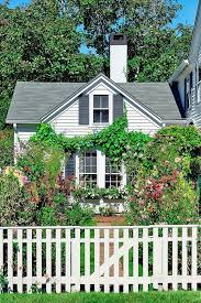 All About Picket Fences Modern Design 1 In 2020 White Picket Fence House Picket Fence Garden White Picket Fence Garden
