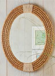 customize an oval mirror by framing it