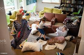 Kids Play And Imagine In Messy Living Room Stock Photo Download Image Now Istock