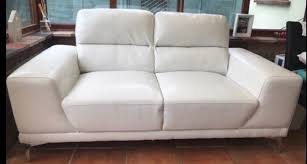 white faux leather sofa settee in