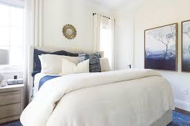 blue and white bedroom with gold