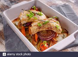 Closeup cod fillet with red onion and ...