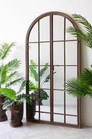 large antique metal window mirror with