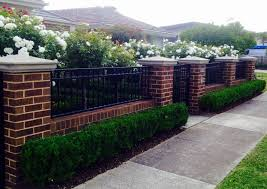 Low Brick Fence With Pillars And Box Hedge Boarder Brick Fence Fence Design Privacy Fence Designs