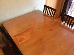 glass top on our wooden kitchen table