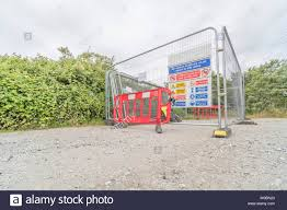 Metal Fencing Round Construction Site Building Materials Pen With Health And Safety Site Safety Warning Signs Stock Photo Alamy