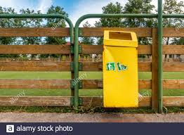 Garbage Bin Hanging On The Wooden Fence Of Sports Ground Stock Photo Alamy