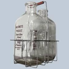 2 vintage half gallon milk bottles in
