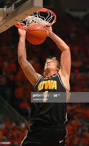 Adam Haluska of the Iowa Hawkeyes dunks against the Illinois Fighting...  News Photo - Getty Images
