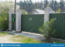 Gate And Fence Of Green Metal And White Brick Among The Vegetation On The Street Stock Image Image Of Gate City 145967961