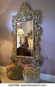 large ornate mirror on purple bedroom