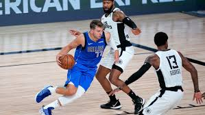Luka Doncic to get MRI following ankle injury in Mavs' Game 3 loss ...