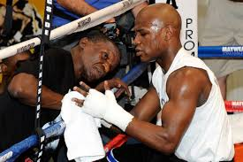 Floyd Mayweather thinking trainer ...