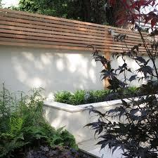 Fence On Top Of Rendered Wall Backyard Fences Wall Trellis Backyard