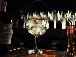 a glass filled with ice on a table next