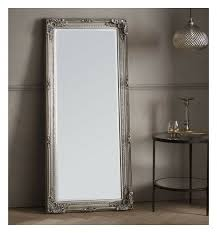 very large silver framed mirror in