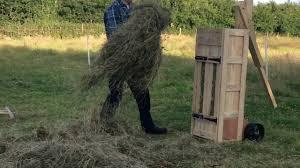 hand made hay bales with a box baler