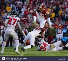 Landover, MD, USA. 4th Nov, 2018. Washington Redskins TE #85 Vernon Davis  hurdles Atlanta Falcons S #41 Sharrod Neasman during a NFL football game  between the Washington Redskins and the Atlanta Falcons