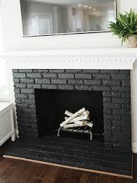 painted black brick fireplace