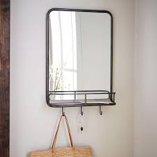 black brown entryway mirror and hooks