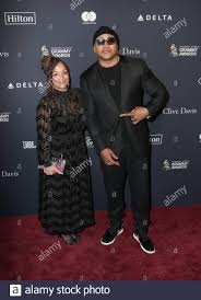 Simone Smith, LL Cool J walking the red carpet at the Clive Davis ...