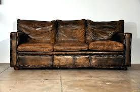 worn leather sofa toprestaurant