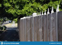Long Wooden Residential Fence With Pointed Tops On It Stock Image Image Of Background Rural 186682765