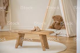Wooden Stool With Shoes On White Round Rug In Kids Room Interior With Plush Toy In Tent Real Photo Stock Photo Download Image Now Istock
