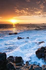 hawaii ocean sunset rocks coast
