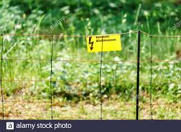 Electric Safety Fence With Danger Sign Stock Photo Alamy