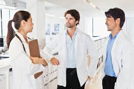 Doctors talking in hallway - Stock Image - F007/9070 - Science ...