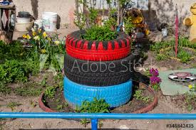 Alternative To Recycling Car Tires Use Both A Fence And Flower Beds Making All Kinds Of Sculptures From Old Tires Buy This Stock Photo And Explore Similar Images At Adobe Stock