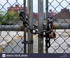 Rusty Chain And Padlock On Chain Link Fence At A Vacant Lot In Stock Photo Alamy