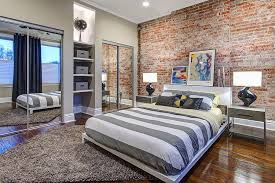 cozy bedrooms with brick walls