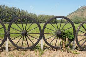 Old Wagon Wheel For The Garden Fence Stock Photo Picture And Royalty Free Image Image 34730908