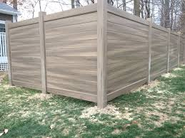 Our New Style Of Privacy Fence 6 Green Teak Pickets That We Ran Horizontally To Get That True Wood Grain Look Vinyl Fence Natural Privacy Fences Fence Design