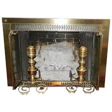 brass andirons with iron fire dog