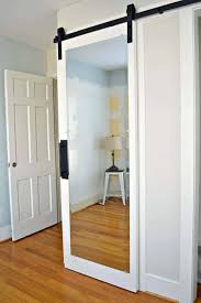 hanging white mirrored barn door on